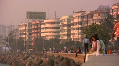 Couples on Mumbai promenade - India Stock Footage