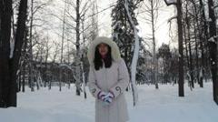 Teenage girl walking in winter park Stock Footage