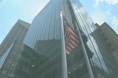 Manhattan Skyscraper with American Flag Stock Footage