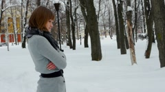 Young female model posing in winter park Stock Footage