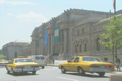 Traffic passes in front of the Metropolitan Museum of Art Stock Footage