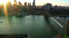 Aerial view of the Setting Sun over Manhattan and the Brooklyn Bridge, NY, USA Stock Footage