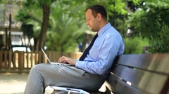 Businessman receiving phone call while working on laptop, steadicam shot HD Stock Footage