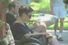 People reading on a sunny day in Central Park Stock Footage