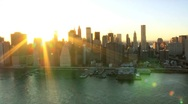 Stock Video Footage of Aerial view of the Setting Sun over Manhattan and the Brooklyn Bridge, NY, USA