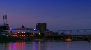 Cincinnati skyline and US Bank Arena at night seen from Ohio river Stock Footage