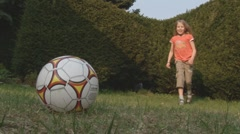 Girl kicking ball (soccer) Stock Footage