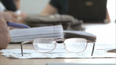 Man moves glasses at the meeting Stock Footage