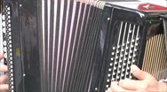 Musician playing on the old accordion Stock Footage