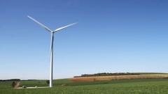 Wind turbine under clear blue sky - stock footage