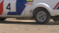 Rally car cornering - detail of wheels and track Stock Footage