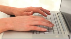 Woman's hands typing on a computer Stock Footage