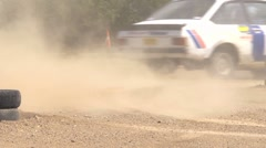 Rally car cornering - detail of wheels and track - lots of dust Stock Footage