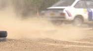 Stock Video Footage of Rally car cornering - detail of wheels and track - lots of dust
