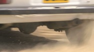 Stock Video Footage of Rally car cornering - close up detail of wheels and track - lots of dust