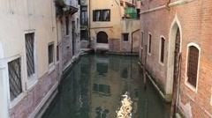 Venice narrow canal between brick buildings P HD 1035 Stock Footage