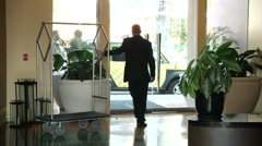 Hotel lobby Bellman and guests 0015PA Stock Footage