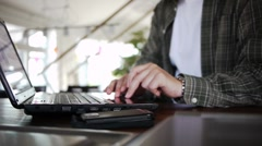 Male with notebook clicking Stock Footage