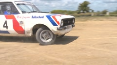 Rally car cornering - demonstrating a sliding turn from inside the curve Stock Footage