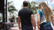 Young couple walking in South Beach Stock Footage