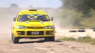 Stock Video Footage of High speed Rally cornering - Subaru Impreza, lots of dust