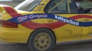 Stock Video Footage of Rally car cornering - Subaru Impreza, lots of dust - from outside the turn.
