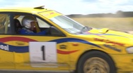 Rally car cornering - Subaru Impreza, lots of dust - from outside the turn. Stock Footage