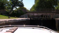 Boat passes through the gateway Stock Footage
