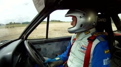 Rally driver demonstrating cornering technique from inside the car Stock Footage