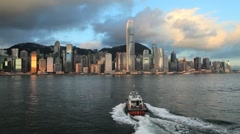 Fast boat crossing Hong Kong Harbour towards Central - stock footage
