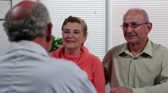 Senior couple in doctor's office - stock footage