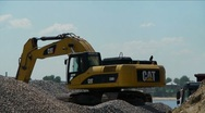 Yellow excavator loading gravel Stock Footage