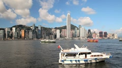 Passenger Ferrys moving across Hong Kong Harbour, China, Asia - stock footage