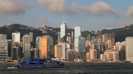Stock Video Footage of Fast Cat ferry traveling across Hong Kong Harbour passed City Skyline, China
