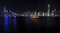 Hong Kong harbour at night with passing river craft, China, Asia, T/Lapse - stock footage