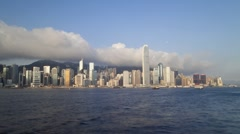 View across Hong Kong Harbour towards Victoria Peak, China, T/Lapse - stock footage