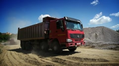 Red truck arrived to load gravel Stock Footage