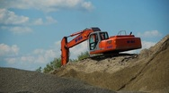Red excavator working on a construction site Stock Footage