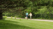 Stock Video Footage of Senior couple walking dog at the park