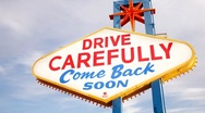 Stock Video Footage of Las Vegas, Nevada, USA, illuminated Drive Carefully sign, - T/lapse
