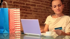 Attracive woman buying online with her laptop and credit card HD Stock Footage