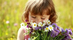 Little girl with flowers laughing Stock Footage