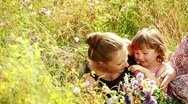Stock Video Footage of Mother and baby in the flowers. They laugh.