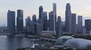 Stock Video Footage of Singapore Skyline in natural and Illuminated light, Asia, T/Lapse