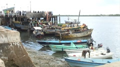 African Ferry Terminal with Jetty & Moored Boats Stock Footage