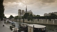 Stock Video Footage of Notre Dame Cathedral on the River Seine, Paris, France, T/Lapse,