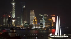 Illuminated New Pudong skyline, Huangpu River Shanghai, China, T/Lapse - stock footage