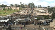 Stock Video Footage of Street view over tin rooftops in African slum - HD