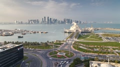 Elevated view over the Museum of Islamic Art, Dhow harbour, Qatar, T/Lapse - stock footage