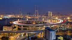 High angle Illuminated view of traffic on Nanpu Bridge spiral, Shanghai, T/Lapse Stock Footage